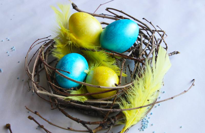 Easter eggs painted in different colors stock images