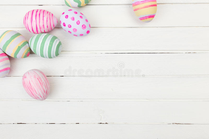 Easter eggs painted in pastel colors on a white stock image