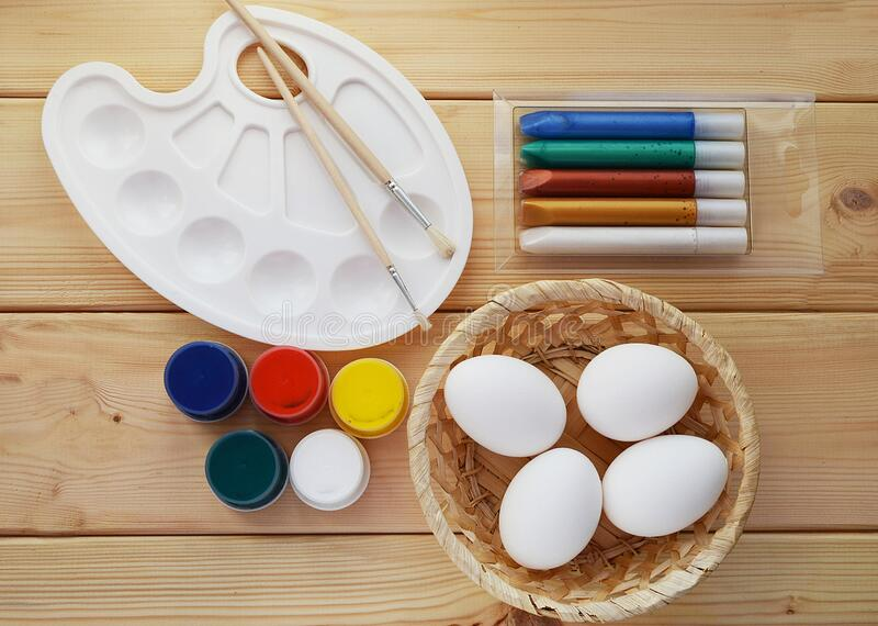 Easter eggs with paints and brushes. Idea for creativity, coloring and decorating eggs for Easter. For children`s clubs royalty free stock image