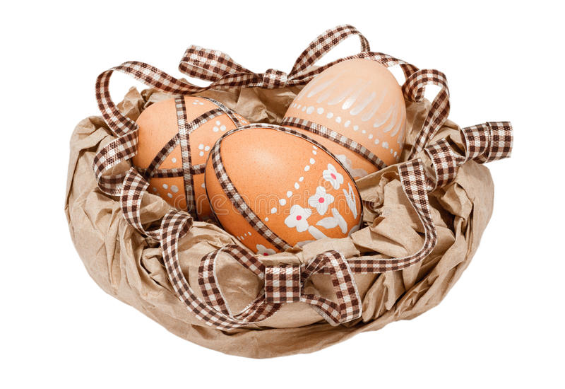 Easter eggs. In a paper basket royalty free stock photos
