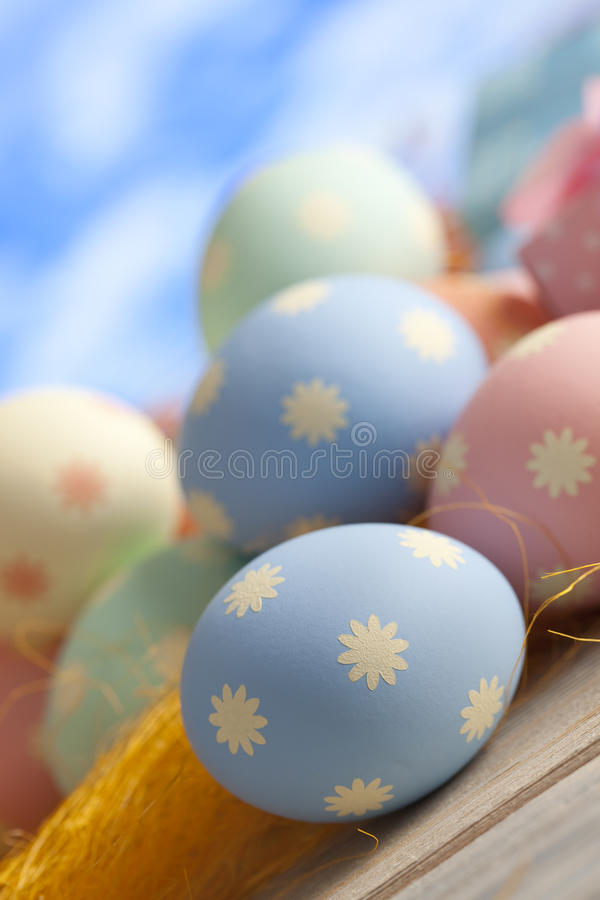 Easter eggs in pastel color on blue background royalty free stock photography