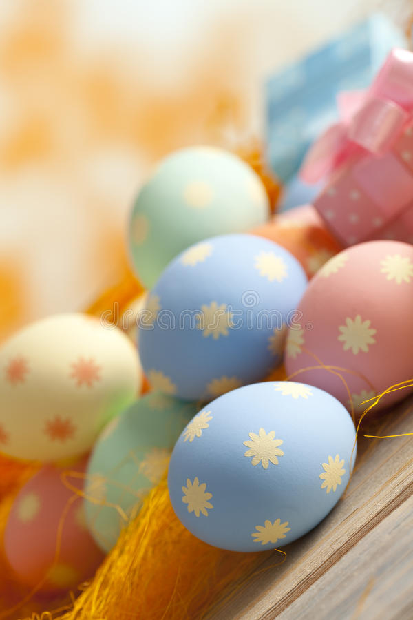 Easter eggs in pastel colors on abstract background stock photography