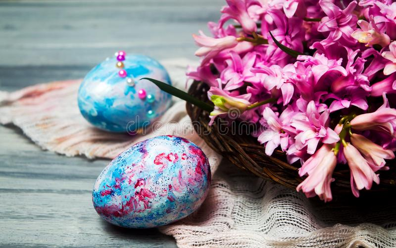 Easter eggs and pink hyacinth flowers royalty free stock photo