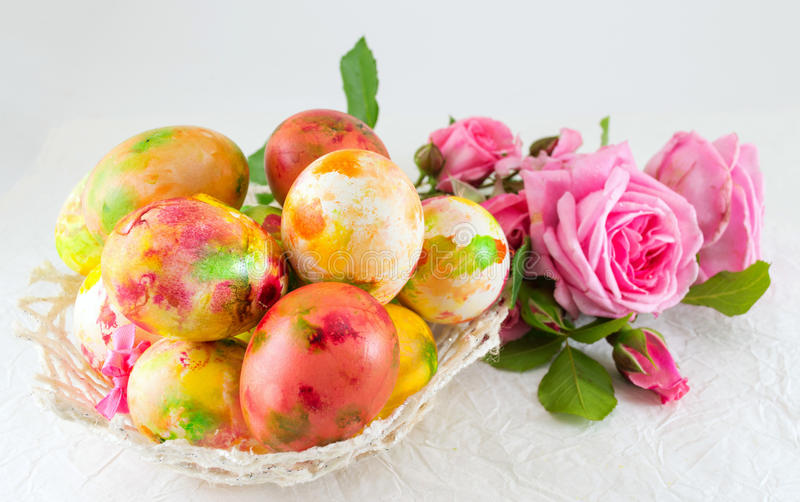 Easter eggs and pink roses bouquet royalty free stock images