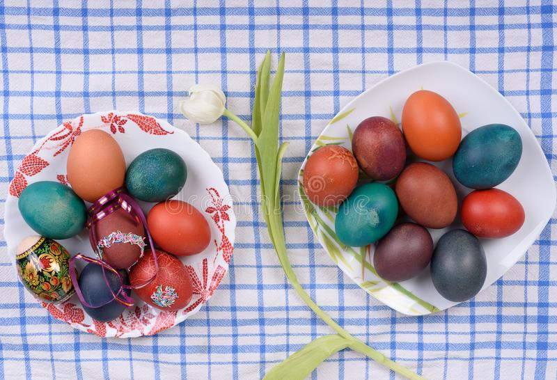 Easter eggs on plates stock photo