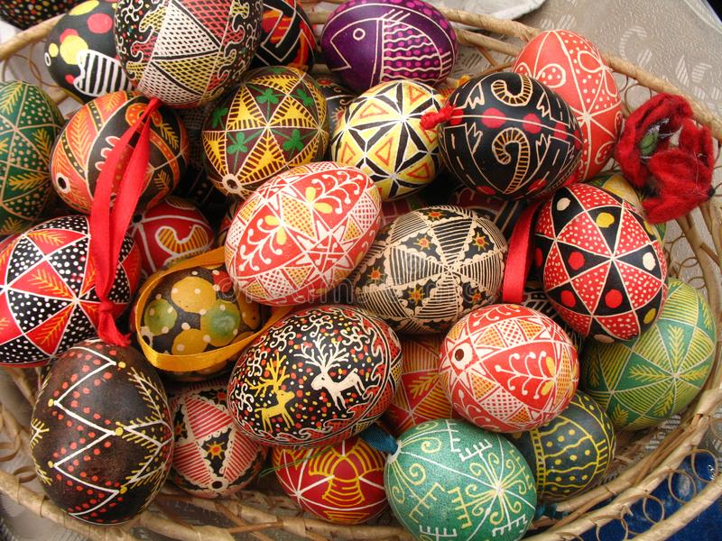 Easter eggs (pysanky) in a basket. A photo of designed traditional ukrainian easter eggs stock photo