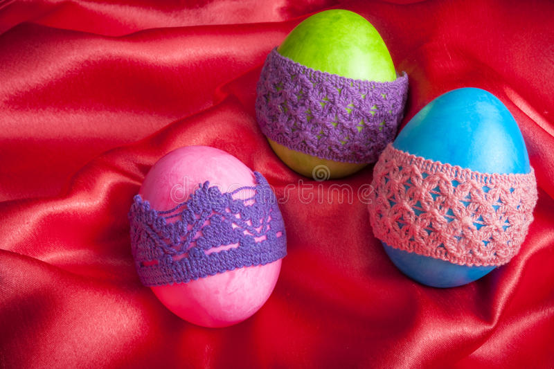 Easter eggs on red satin stock photos