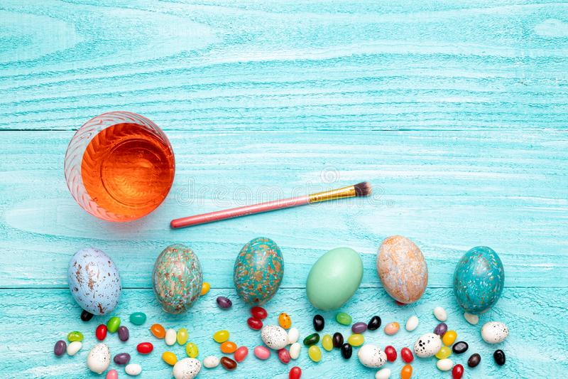 Easter eggs holiday flat lay room for text colorful clean easter bunny jelly beans royalty free stock images