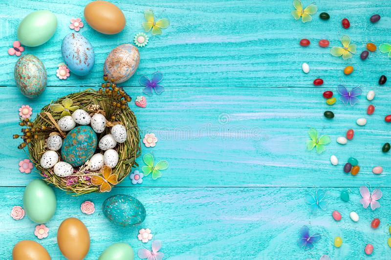 Easter eggs holiday flat lay room for text colorful clean easter bunny jelly beans stock image