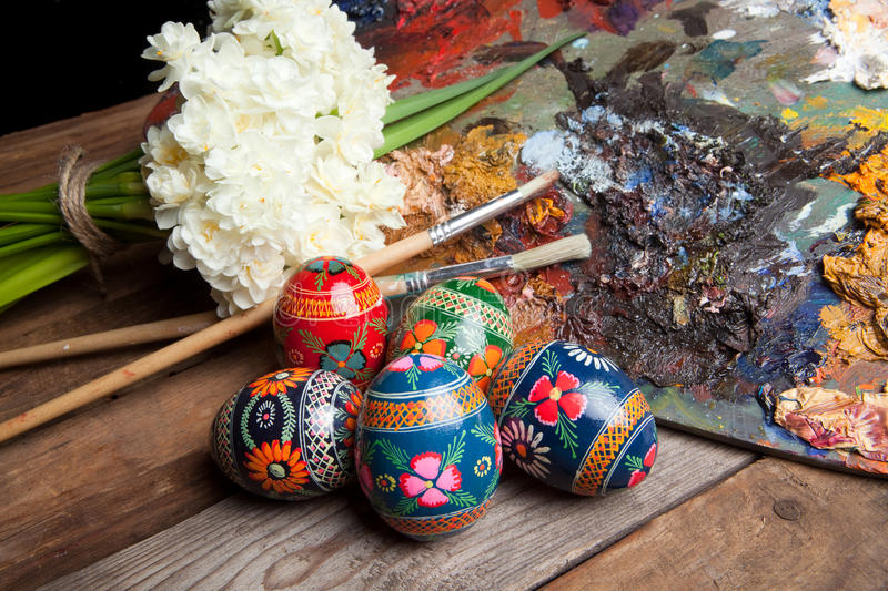 Easter eggs from Russia. Painter's pallet with brushes and russian easter eggs stock image