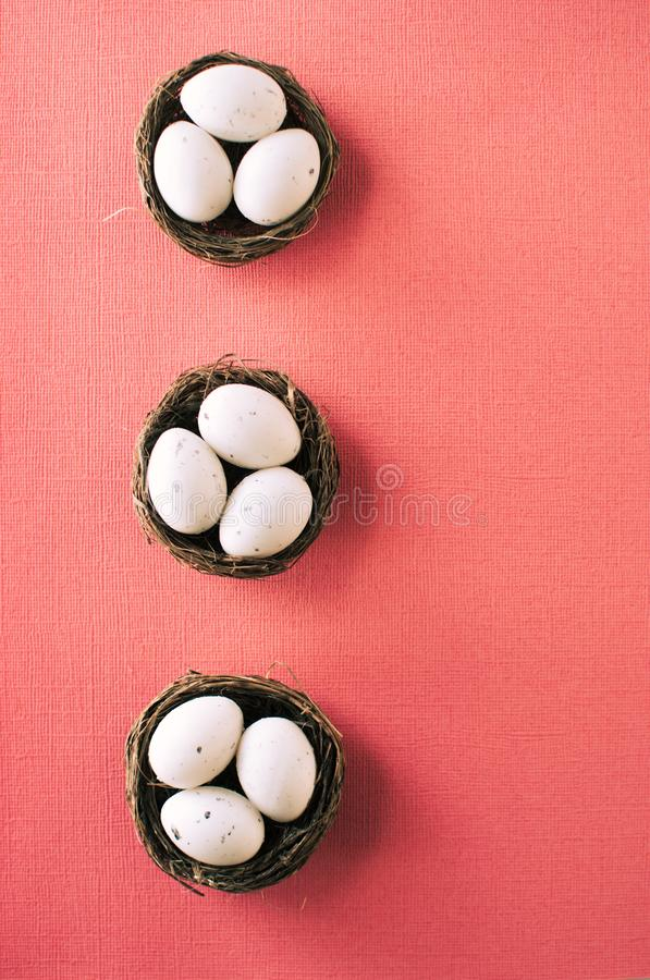 Easter eggs in small baskets. stock photography