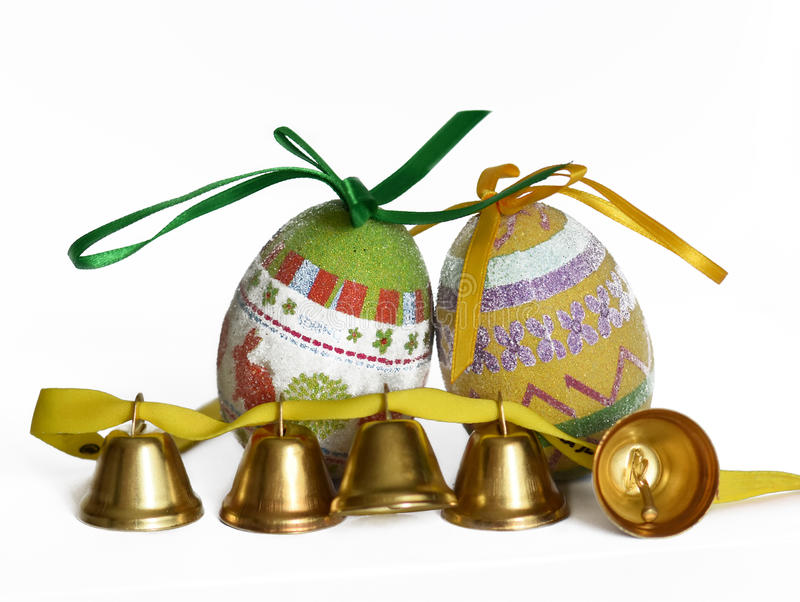 Easter eggs and small bells stock images