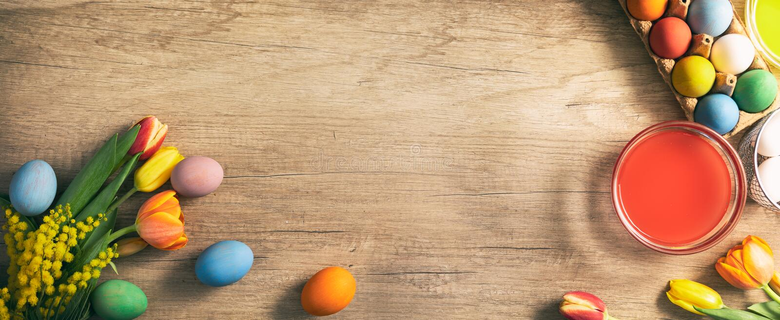 Easter eggs with sprig flowers on wooden table royalty free stock photo