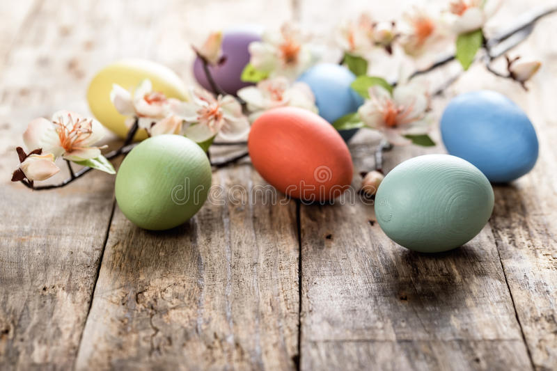 Easter eggs. And spring blossoms on the wooden surface stock image
