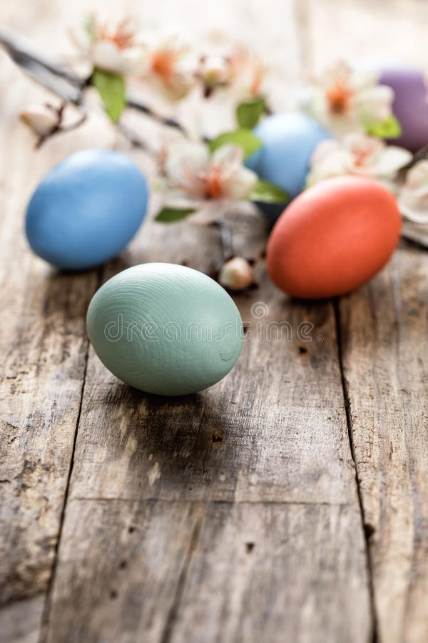 Easter eggs. And spring blossoms on the wooden surface stock photo