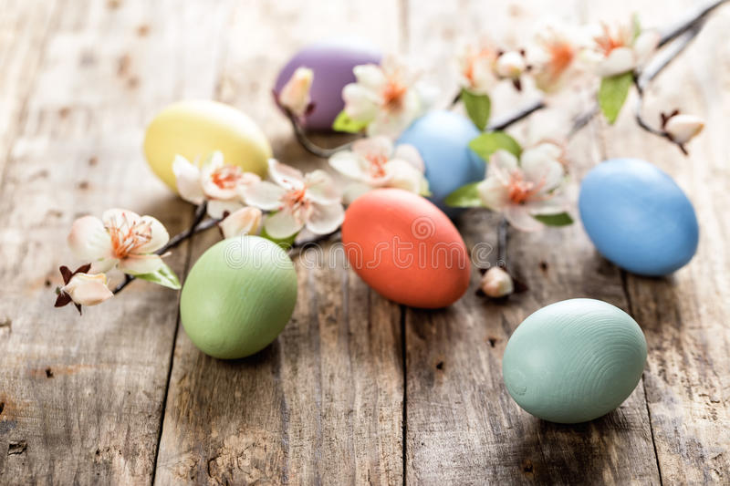 Easter eggs. And spring blossoms on the wooden surface royalty free stock photo