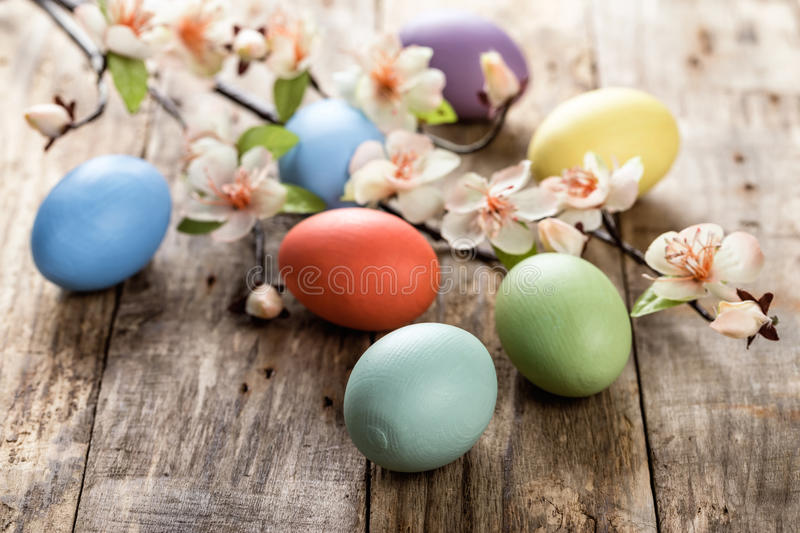 Easter eggs. And spring blossoms on the wooden surface stock photos