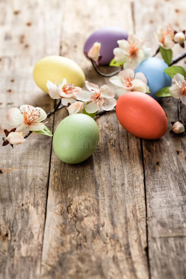 Easter eggs. And spring blossoms on the wooden surface royalty free stock image