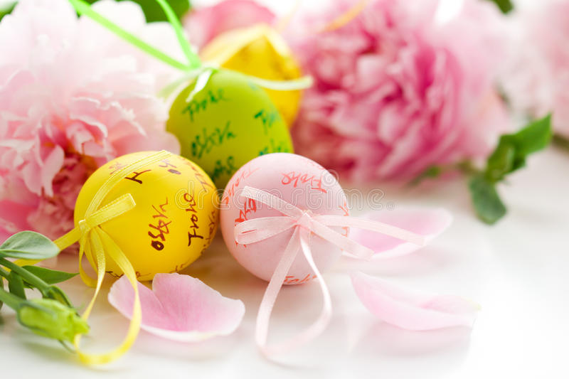 Easter eggs and spring flowers stock photo