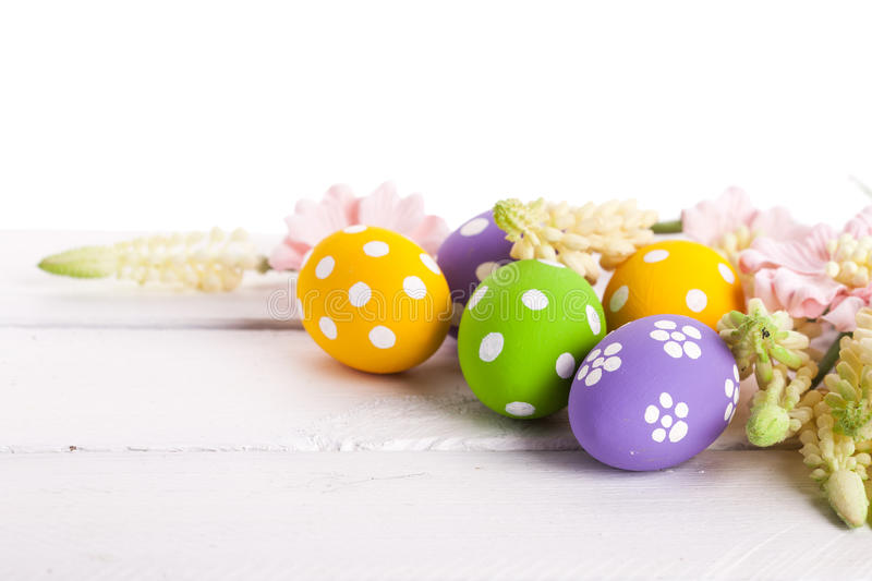 Easter Eggs with Spring Flowers. Studi shot stock photo