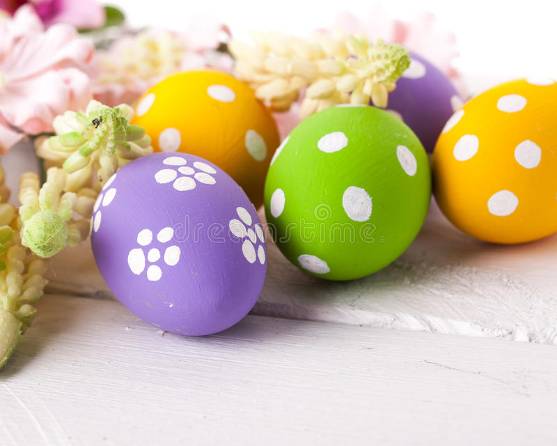 Easter Eggs with Spring Flowers. Studio shot royalty free stock image