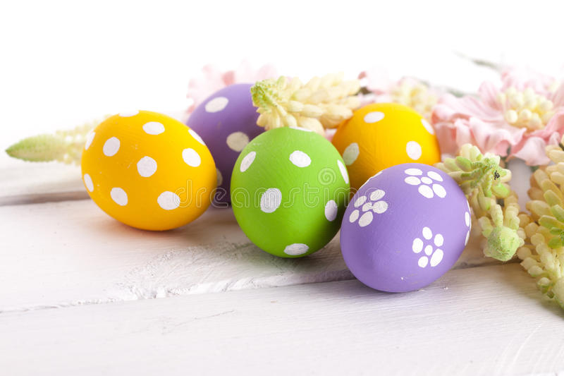 Easter Eggs with Spring Flowers. Studio shot royalty free stock photo