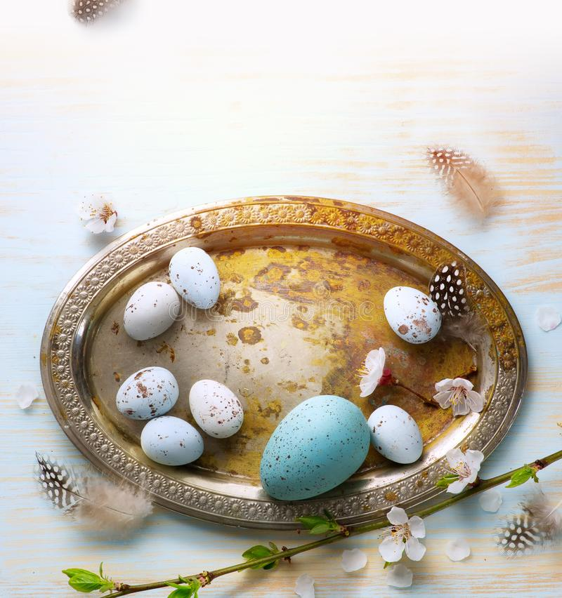 Easter Eggs with Spring Flowers on White Wooden Background stock photo