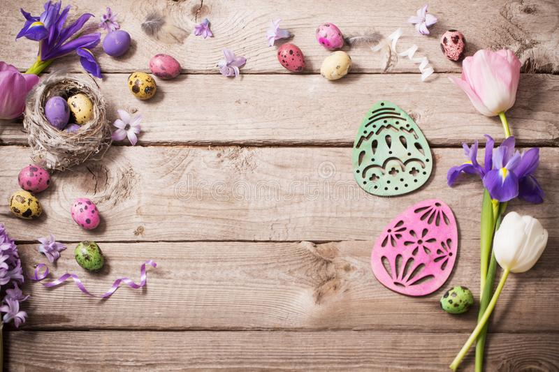 Easter eggs with spring flowers on wooden background stock image