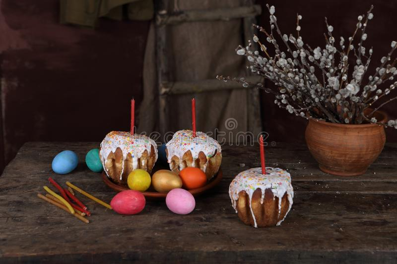 Easter cakes, painted eggs and a bouquet of willow stock photography