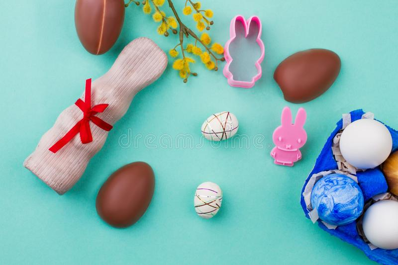 Easter eggs and sweets on colorful background. royalty free stock image