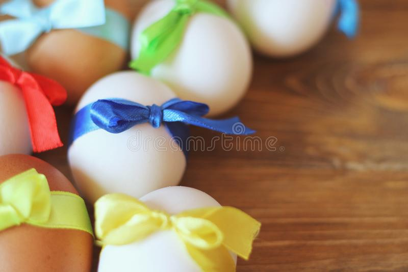 Easter eggs are tied with colored ribbons satin ribbons. Close-up. royalty free stock images