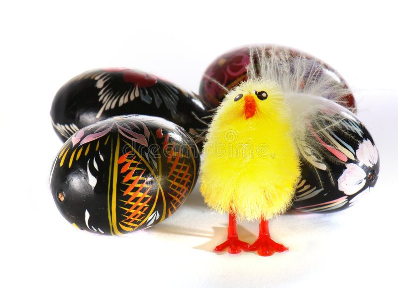 Easter eggs and a toy chicken royalty free stock photo