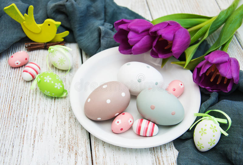 Easter eggs and tulips. On a old wooden table royalty free stock photos