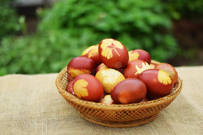 Easter eggs in vintage basket royalty free stock photos