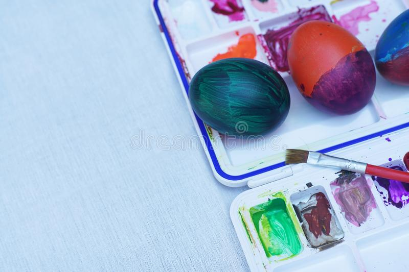 Easter eggs and water color palette. Happy and fun Easter concept. Copy space royalty free stock images