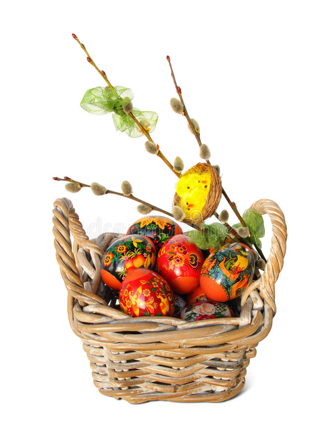Easter eggs, willow twigs and nest with chicks stock photos