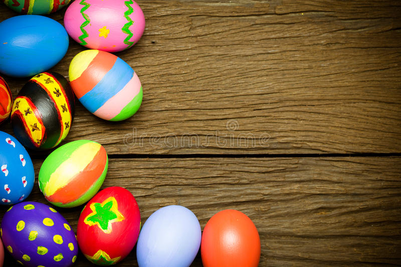 Easter eggs on wood background stock photography
