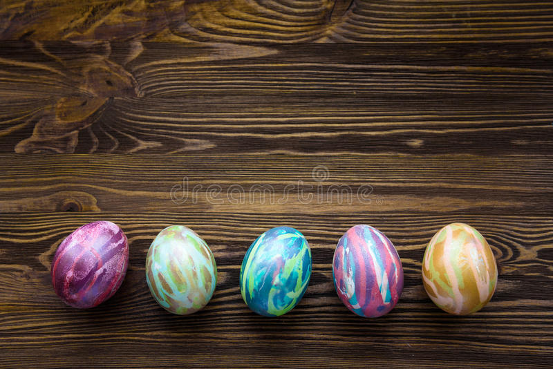 Easter eggs on wooden background. Colorful, bright stock photo