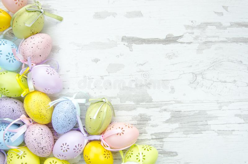 Easter eggs on wooden background. Flat lay, top view, Mock up royalty free stock image