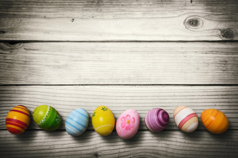 Easter eggs on wooden background stock photos