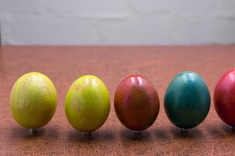 Easter eggs on wooden background, white boards with group of eggs, top view . Easter eggs on wooden background, white boards with group of eggs, top view royalty free stock photo