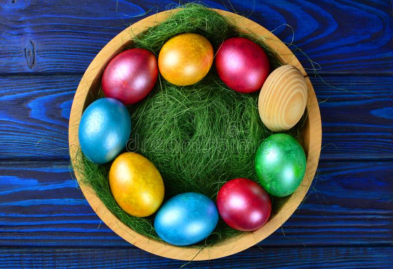 Easter eggs in a wooden plate stock images