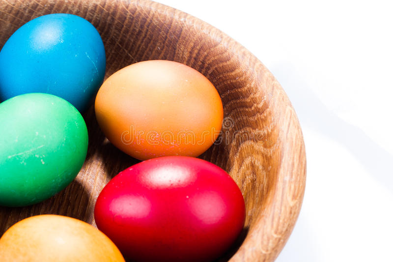 Easter eggs and wooden plate isolated on white stock photo