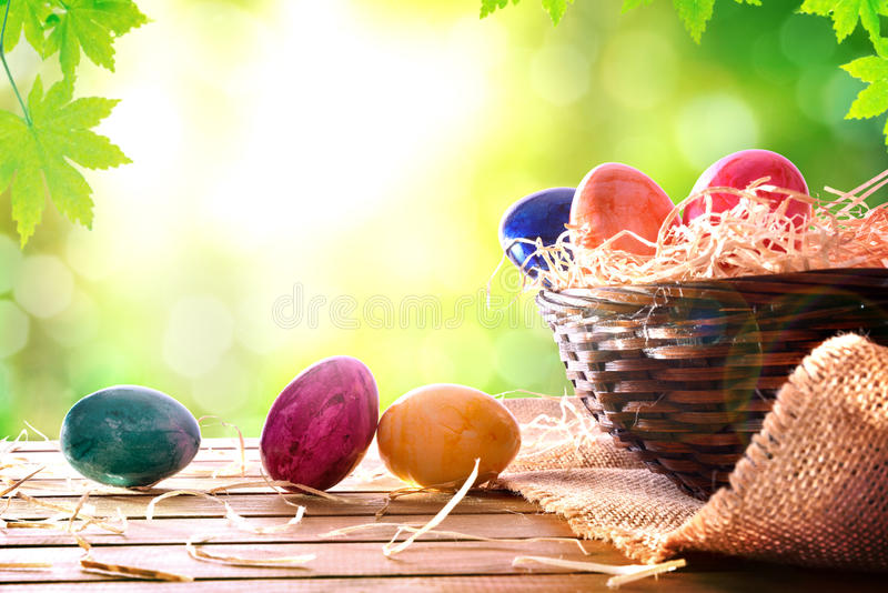 Easter eggs on a wooden table in nature front view stock images