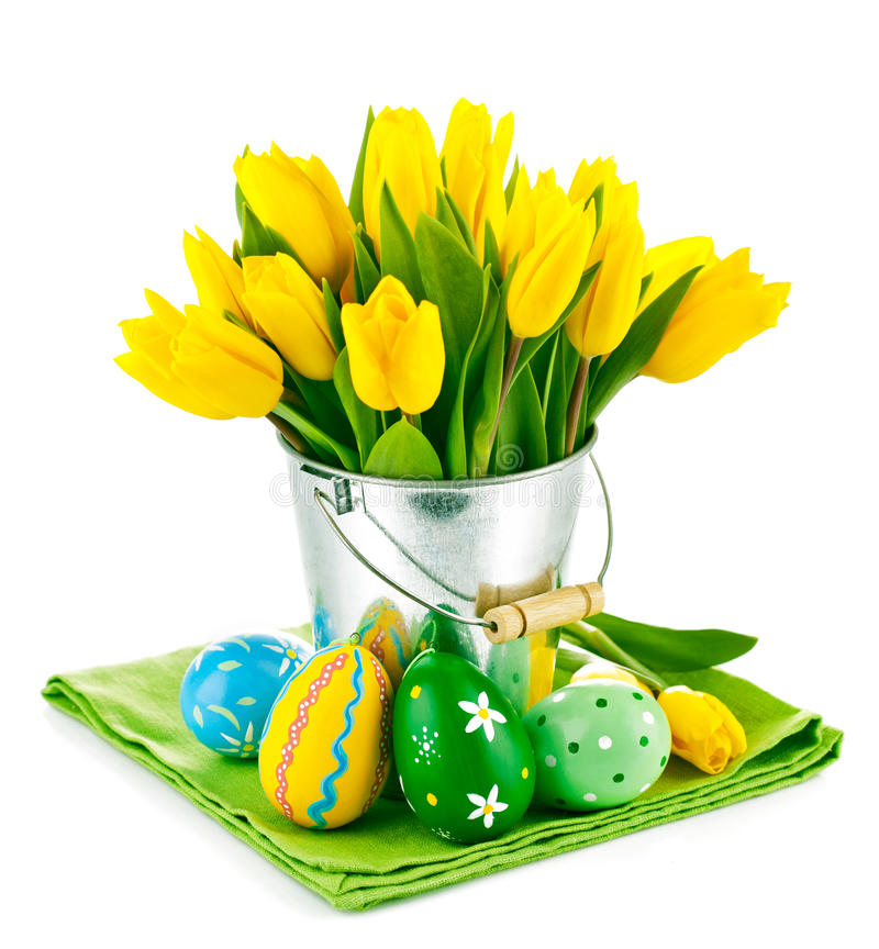Easter eggs with yellow tulips in bucket stock image