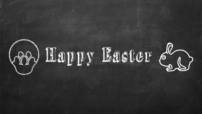 Easter feliz escrito no quadro preto fotografia de stock royalty free