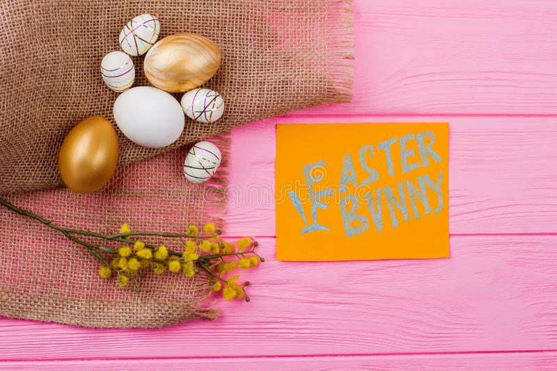 Easter festive composition on pink wood. stock images