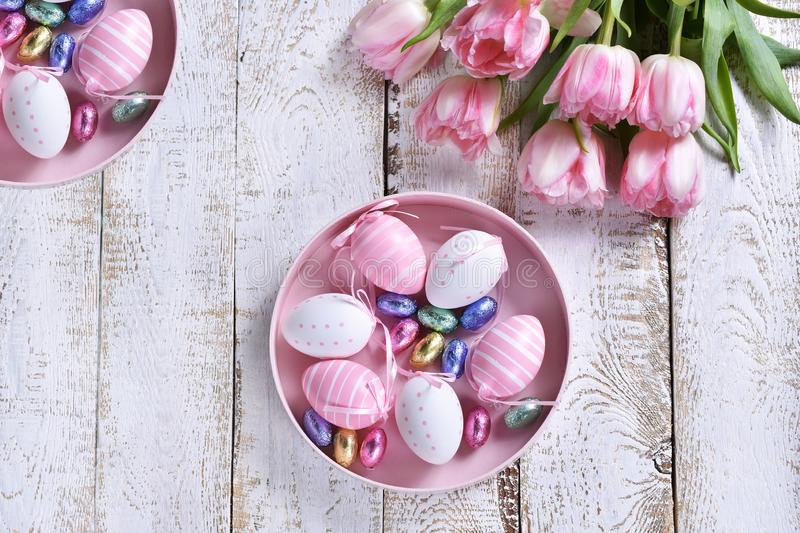 Easter flat lay with painted eggs and pink tulips royalty free stock photos