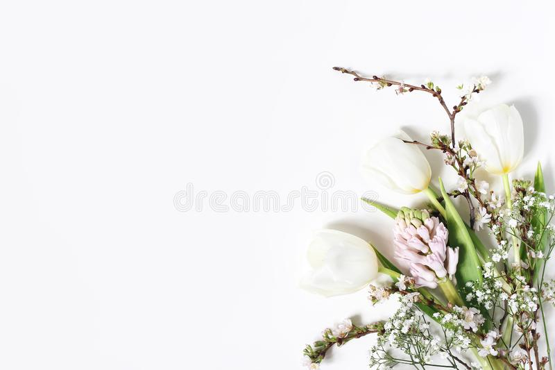 Easter floral frame, web banner. Spring wedding, birthday composition with pink hyacinth, cherry blossoms, tulips and royalty free stock photography
