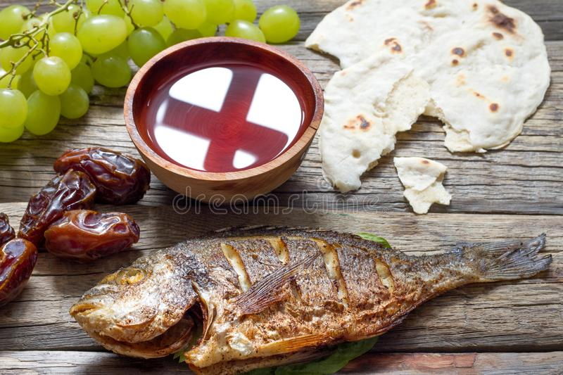 Easter food with fish passover bread cross in goblet of wine last supper abstract royalty free stock image